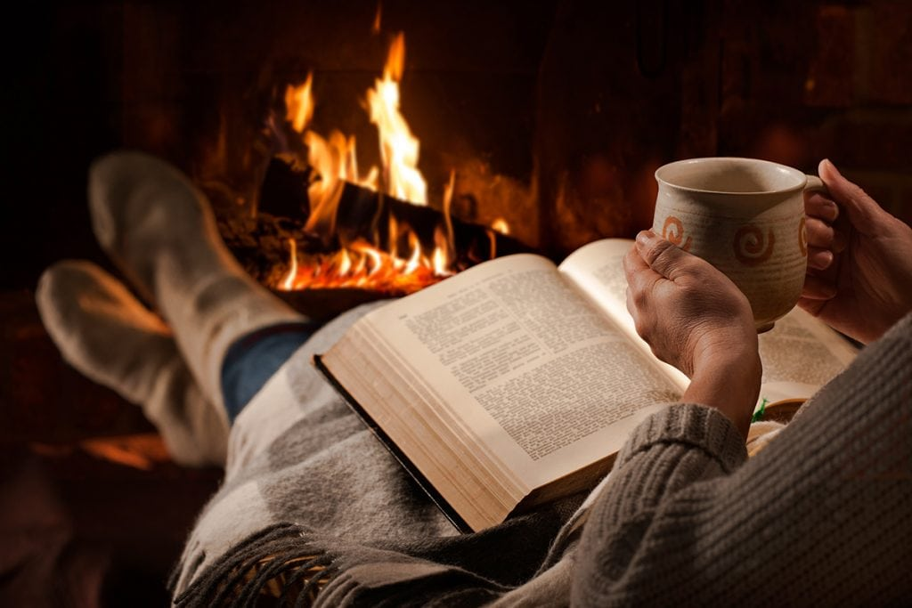 Reading in Front of Fire